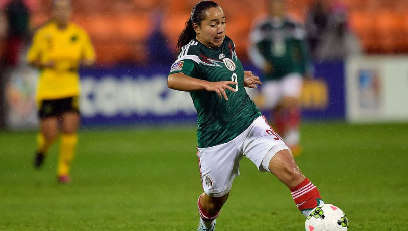 WASHINGTON, DC - OCTOBER 21: Veronica Charlyn Corral #9 of Mexico dribbles the ball in the first half of a game against Jamaica during the 2014 CONCACAF Women's Championship at RFK Stadium on October 21, 2014 in Washington, DC. (Photo by Patrick McDermott/Getty Images)